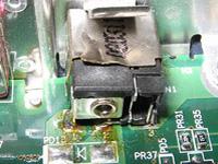 Conector desoldado y roto